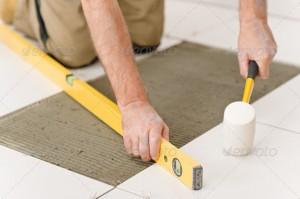 Home_improvement_renovation_-_handyman_laying_tile